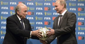 Russia's President Vladimir Putin (R) and FIFA President Sepp Blatter take part in the official hand over ceremony for the 2018 World Cup scheduled to take place in Russia, in Rio de Janeiro July 13, 2014.    REUTERS/Alexey Nikolsky/RIA Novosti/Kremlin          ( BRAZIL - Tags: SPORT SOCCER WORLD CUP POLITICS) ATTENTION EDITORS - THIS PICTURE WAS PROVIDED BY A THIRD PARTY. REUTERS IS UNABLE TO INDEPENDENTLY VERIFY THE AUTHENTICITY, CONTENT, LOCATION OR DATE OF THIS IMAGE. FOR EDITORIAL USE ONLY. NOT FOR SALE FOR MARKETING OR ADVERTISING CAMPAIGNS. NO SALES. NO ARCHIVES. FOR EDITORIAL USE ONLY. NOT FOR SALE FOR MARKETING OR ADVERTISING CAMPAIGNS. THIS PICTURE IS DISTRIBUTED EXACTLY AS RECEIVED BY REUTERS, AS A SERVICE TO CLIENTS